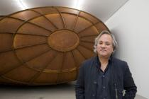 "Anish Kapoor in front of his sculpture ""Memory"", Deutsche Guggenheim, Berlin, 2009. Photo: Mathias Schormann. © Deutsche Guggenheim Berlin"