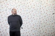 Nedko Solakov in front of �A Wallpaper (on the 23rd floor)�, 2010 � 2011, in the Deutsche Bank Towers. Frankfurt January 2011. Photo � Alex Kraus