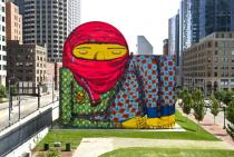 A new mural by Os Gêmeos, a complement to their ICA show, covers the exterior wall of a giant air intake structure on the Rose F. Kennedy Greenway, Boston. Photo Geoff Hargadon. Courtesy Os Gêmeos