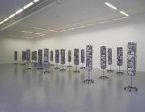 Mathilde ter Heijne, Woman to Go, 2003�. Offset prints on postcards and metal rack. Installation shot �It's Time for Action�, Migros Museum f�r Gegenwartskunst, Z�rich. � Mathilde ter Heijne
