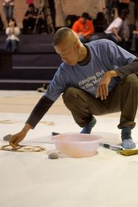 Cai Guo-Qiang creating the gunpowder drawing Day and Night, Taipei, 2009. Photo by On-Works