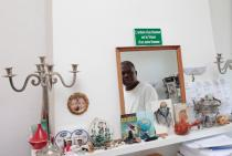 Man in the mirror. Meschac Gaba at his Rotterdam home. Photo: Pavel Prokopchik, 2014.